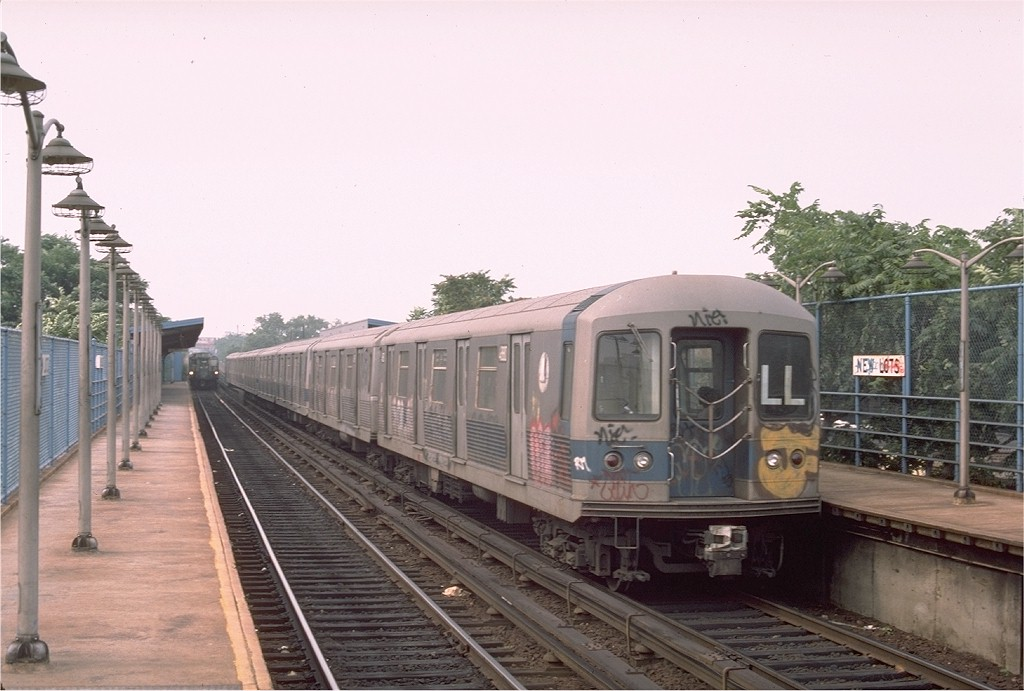 (166k, 1024x691)<br><b>Country:</b> United States<br><b>City:</b> New York<br><b>System:</b> New York City Transit<br><b>Line:</b> BMT Canarsie Line<br><b>Location:</b> New Lots Avenue <br><b>Route:</b> LL<br><b>Car:</b> R-42 (St. Louis, 1969-1970)  4880 <br><b>Photo by:</b> Ed McKernan<br><b>Collection of:</b> Joe Testagrose<br><b>Date:</b> 8/12/1976<br><b>Viewed (this week/total):</b> 3 / 3099