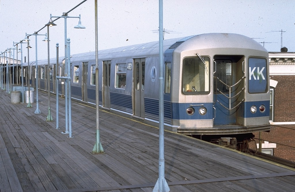 (196k, 1024x668)<br><b>Country:</b> United States<br><b>City:</b> New York<br><b>System:</b> New York City Transit<br><b>Line:</b> BMT Nassau Street/Jamaica Line<br><b>Location:</b> Crescent Street <br><b>Route:</b> KK<br><b>Car:</b> R-42 (St. Louis, 1969-1970)  4921 <br><b>Photo by:</b> Doug Grotjahn<br><b>Collection of:</b> Joe Testagrose<br><b>Date:</b> 8/1/1972<br><b>Viewed (this week/total):</b> 4 / 4798