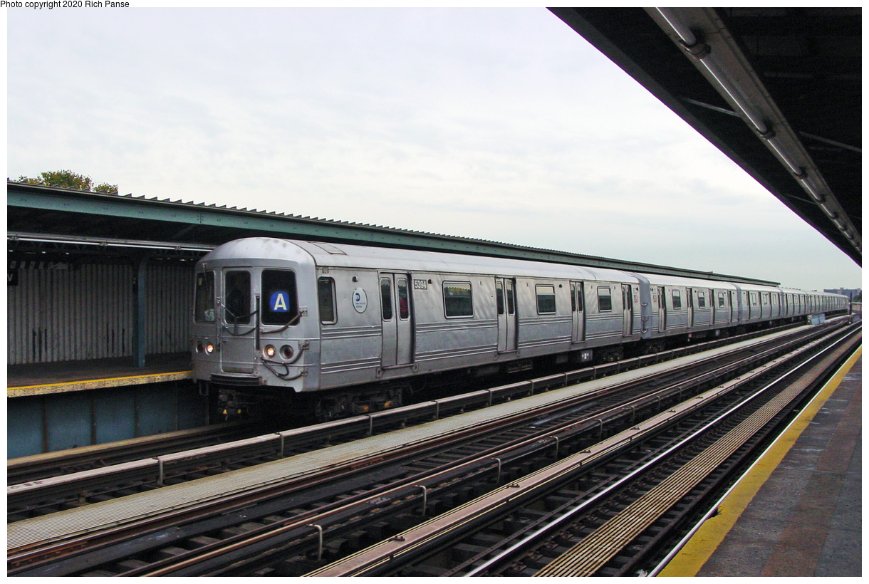 (66k, 820x620)<br><b>Country:</b> United States<br><b>City:</b> New York<br><b>System:</b> New York City Transit<br><b>Line:</b> IND Fulton Street Line<br><b>Location:</b> 111th Street/Greenwood Avenue <br><b>Car:</b> R-44 (St. Louis, 1971-73) 5394 <br><b>Photo by:</b> Richard Panse<br><b>Date:</b> 12/3/2002<br><b>Viewed (this week/total):</b> 2 / 5214