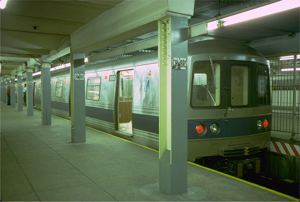 (161k, 1024x690)<br><b>Country:</b> United States<br><b>City:</b> New York<br><b>System:</b> New York City Transit<br><b>Line:</b> IND 8th Avenue Line<br><b>Location:</b> Chambers Street/World Trade Center <br><b>Route:</b> E<br><b>Car:</b> R-46 (Pullman-Standard, 1974-75) 1000 <br><b>Photo by:</b> Doug Grotjahn<br><b>Collection of:</b> Joe Testagrose<br><b>Date:</b> 6/26/1977<br><b>Viewed (this week/total):</b> 2 / 5735