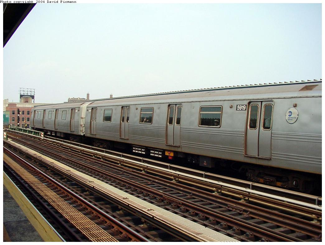 (130k, 1044x788)<br><b>Country:</b> United States<br><b>City:</b> New York<br><b>System:</b> New York City Transit<br><b>Line:</b> BMT Culver Line<br><b>Location:</b> Ditmas Avenue <br><b>Route:</b> F<br><b>Car:</b> R-46 (Pullman-Standard, 1974-75) 5919 <br><b>Photo by:</b> David Pirmann<br><b>Date:</b> 8/27/2000<br><b>Viewed (this week/total):</b> 0 / 2551