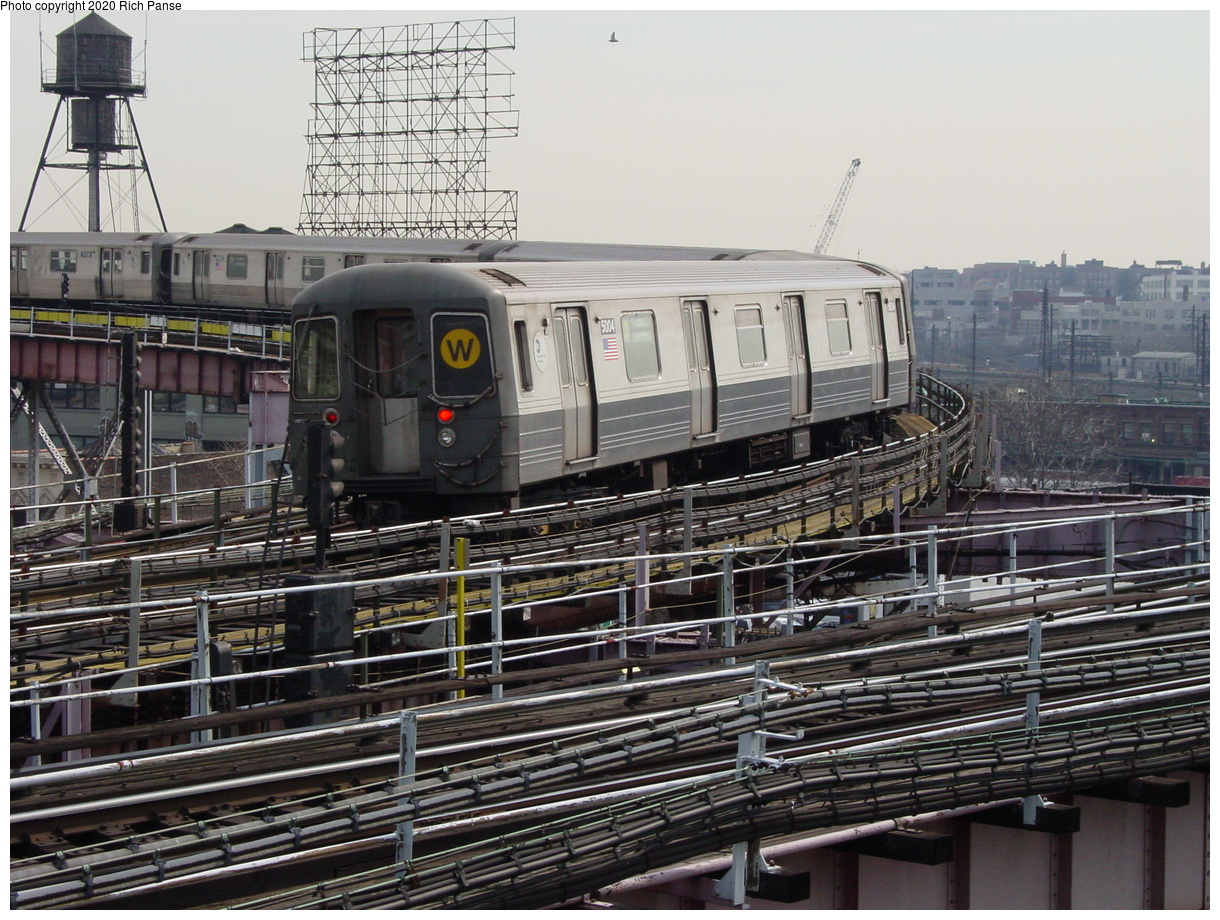 (102k, 820x620)<br><b>Country:</b> United States<br><b>City:</b> New York<br><b>System:</b> New York City Transit<br><b>Line:</b> BMT Astoria Line<br><b>Location:</b> Queensborough Plaza <br><b>Route:</b> N<br><b>Car:</b> R-68A (Kawasaki, 1988-1989)  5004 <br><b>Photo by:</b> Richard Panse<br><b>Date:</b> 3/7/2002<br><b>Viewed (this week/total):</b> 5 / 4582