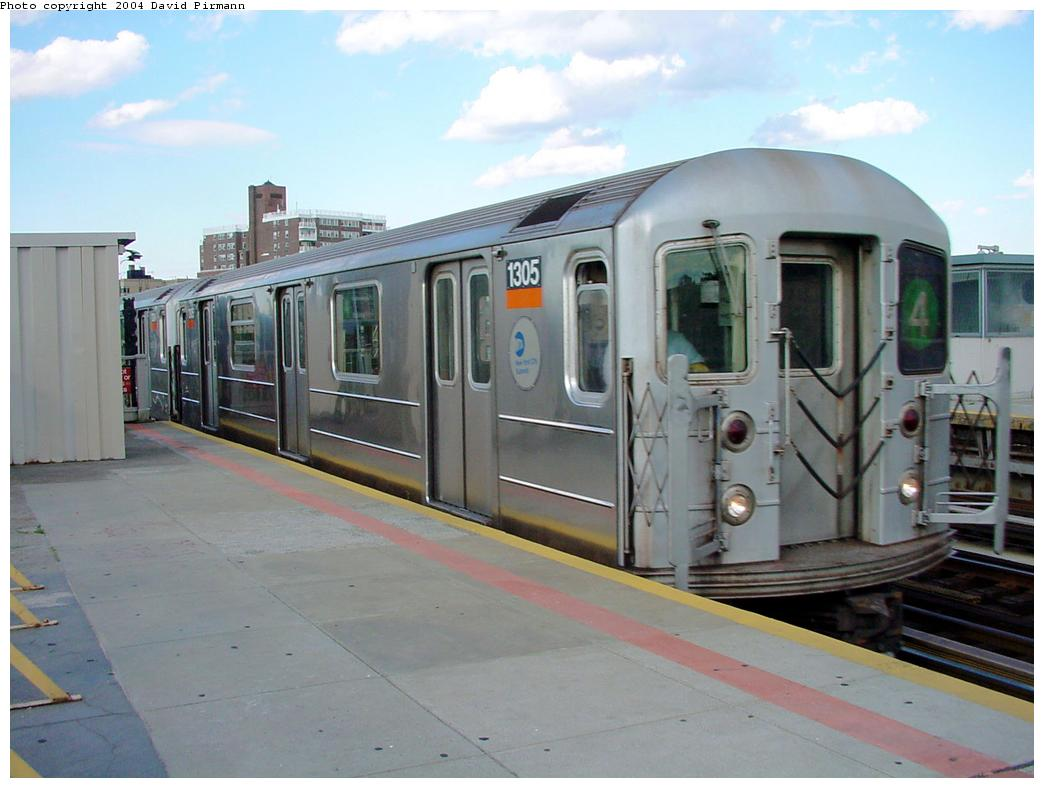 (100k, 1044x788)<br><b>Country:</b> United States<br><b>City:</b> New York<br><b>System:</b> New York City Transit<br><b>Line:</b> IRT Woodlawn Line<br><b>Location:</b> Bedford Park Boulevard <br><b>Route:</b> 4<br><b>Car:</b> R-62 (Kawasaki, 1983-1985)  1305 <br><b>Photo by:</b> David Pirmann<br><b>Date:</b> 7/12/2001<br><b>Viewed (this week/total):</b> 1 / 5405