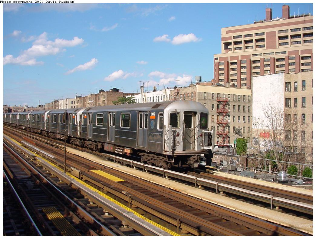 (160k, 1044x788)<br><b>Country:</b> United States<br><b>City:</b> New York<br><b>System:</b> New York City Transit<br><b>Line:</b> IRT Woodlawn Line<br><b>Location:</b> Mosholu Parkway <br><b>Route:</b> 4<br><b>Car:</b> R-62 (Kawasaki, 1983-1985)  1305 <br><b>Photo by:</b> David Pirmann<br><b>Date:</b> 7/12/2001<br><b>Viewed (this week/total):</b> 0 / 5078