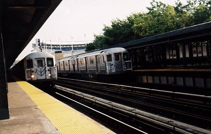 (88k, 880x561)<br><b>Country:</b> United States<br><b>City:</b> New York<br><b>System:</b> New York City Transit<br><b>Line:</b> IRT Woodlawn Line<br><b>Location:</b> 161st Street/River Avenue (Yankee Stadium) <br><b>Route:</b> 4<br><b>Car:</b> R-62 (Kawasaki, 1983-1985)  1326 <br><b>Photo by:</b> Gary Chatterton<br><b>Date:</b> 2002<br><b>Notes:</b> With R62 1471<br><b>Viewed (this week/total):</b> 3 / 4585