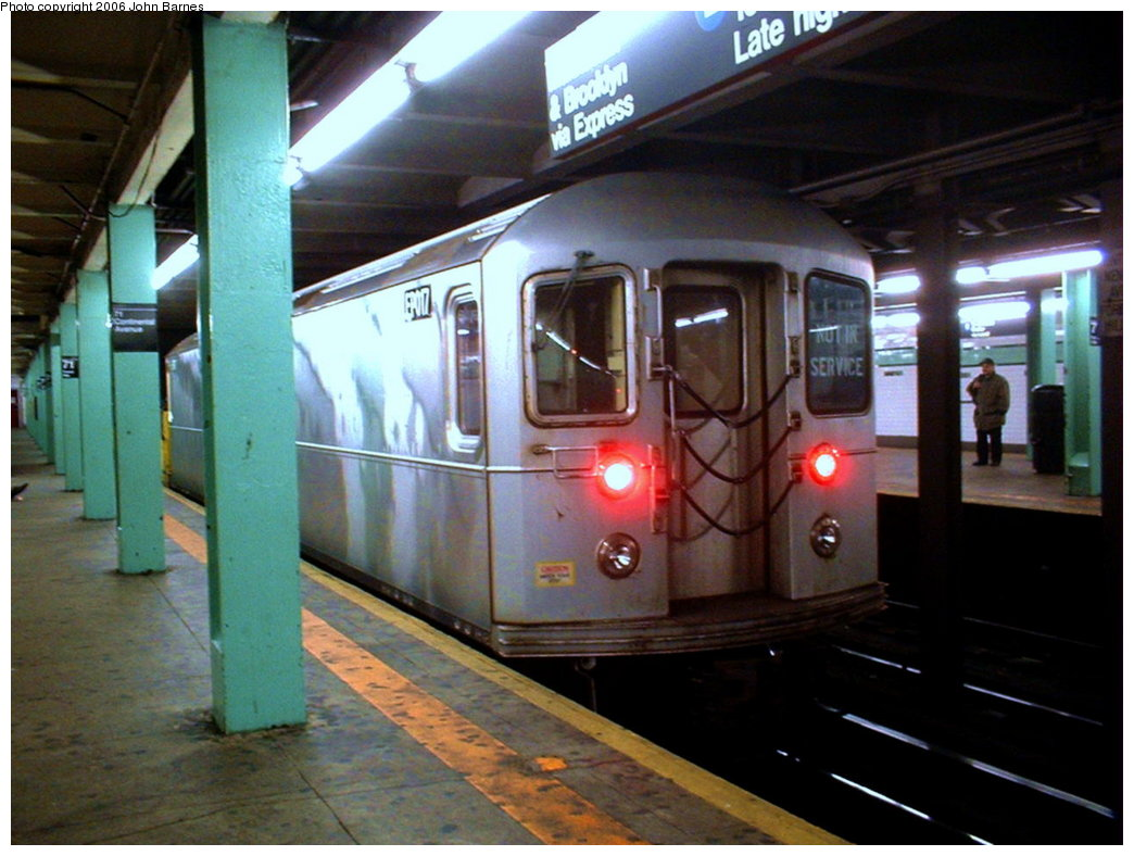 (167k, 1044x788)<br><b>Country:</b> United States<br><b>City:</b> New York<br><b>System:</b> New York City Transit<br><b>Line:</b> IND Queens Boulevard Line<br><b>Location:</b> 71st/Continental Aves./Forest Hills <br><b>Route:</b> Work Service<br><b>Car:</b> R-127/R-134 (Kawasaki, 1991-1996) EP017 <br><b>Photo by:</b> John Barnes<br><b>Date:</b> 11/17/2003<br><b>Viewed (this week/total):</b> 6 / 3141
