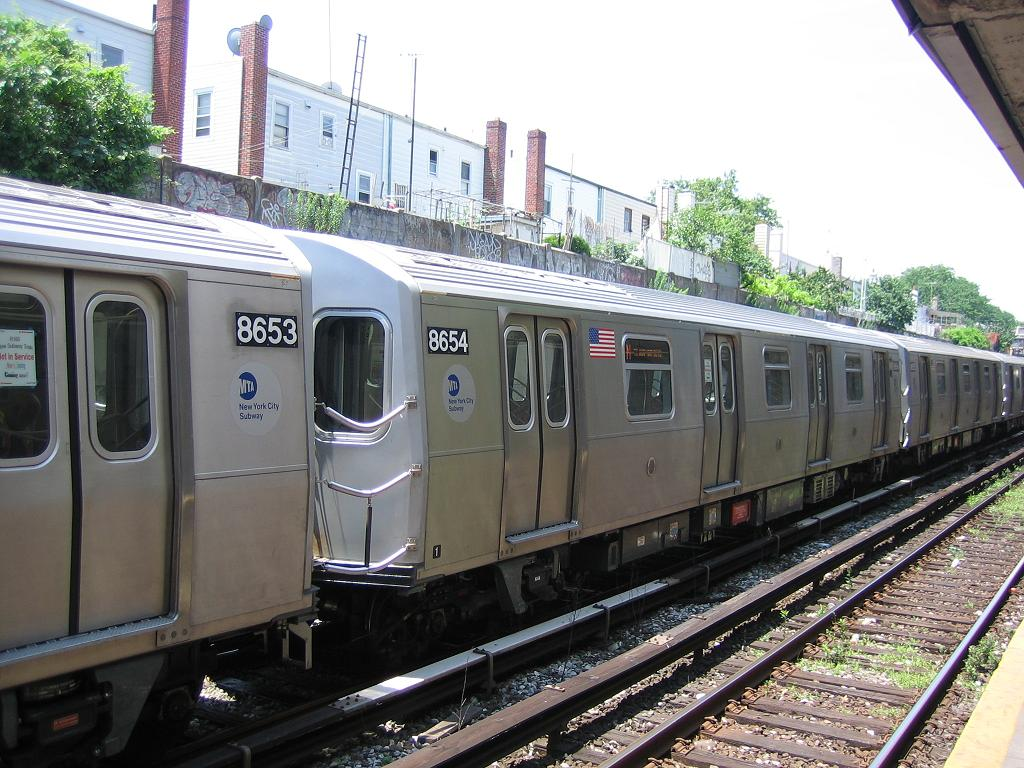 (153k, 1024x768)<br><b>Country:</b> United States<br><b>City:</b> New York<br><b>System:</b> New York City Transit<br><b>Line:</b> BMT Sea Beach Line<br><b>Location:</b> 18th Avenue <br><b>Car:</b> R-160A-2 (Alstom, 2005-2008, 5 car sets)  8654 <br><b>Photo by:</b> Michael Hodurski<br><b>Date:</b> 6/21/2006<br><b>Notes:</b> Test train on the Sea Beach line middle (express) track.<br><b>Viewed (this week/total):</b> 0 / 2613