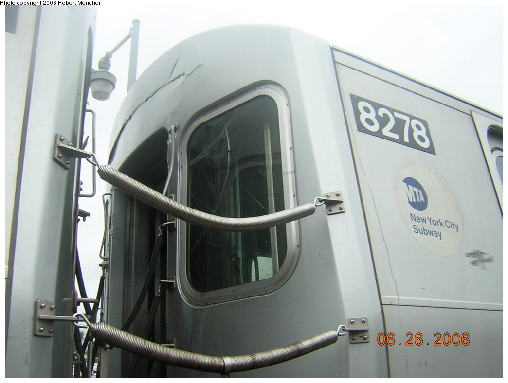 (152k, 1044x788)<br><b>Country:</b> United States<br><b>City:</b> New York<br><b>System:</b> New York City Transit<br><b>Location:</b> Rockaway Parkway (Canarsie) Yard<br><b>Car:</b> R-143 (Kawasaki, 2001-2002) 8278 <br><b>Photo by:</b> Robert Mencher<br><b>Date:</b> 6/26/2006<br><b>Notes:</b> Note bonnet damage-- blind end of 2nd car in consist involved in 6/21 accident in Canarsie Yard.<br><b>Viewed (this week/total):</b> 1 / 4408
