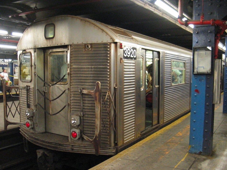 (170k, 950x713)<br><b>Country:</b> United States<br><b>City:</b> New York<br><b>System:</b> New York City Transit<br><b>Line:</b> IND 8th Avenue Line<br><b>Location:</b> 59th Street/Columbus Circle <br><b>Route:</b> E<br><b>Car:</b> R-32 (Budd, 1964)  3920 <br><b>Photo by:</b> David of Broadway<br><b>Date:</b> 7/16/2006<br><b>Notes:</b> E train via Central Park West reroute.<br><b>Viewed (this week/total):</b> 0 / 3238