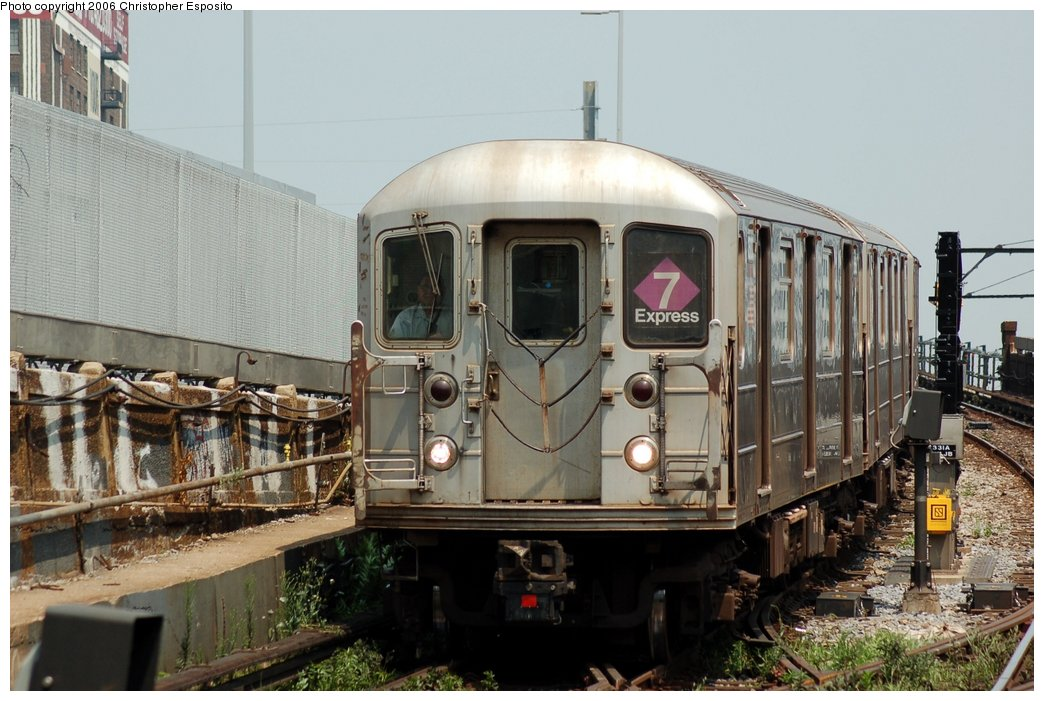 (155k, 1044x701)<br><b>Country:</b> United States<br><b>City:</b> New York<br><b>System:</b> New York City Transit<br><b>Line:</b> IRT Flushing Line<br><b>Location:</b> Viaduct approach east of Hunterspoint Ave. <br><b>Route:</b> 7<br><b>Car:</b> R-62A (Bombardier, 1984-1987)   <br><b>Photo by:</b> Christopher Esposito<br><b>Date:</b> 7/26/2006<br><b>Viewed (this week/total):</b> 2 / 1872
