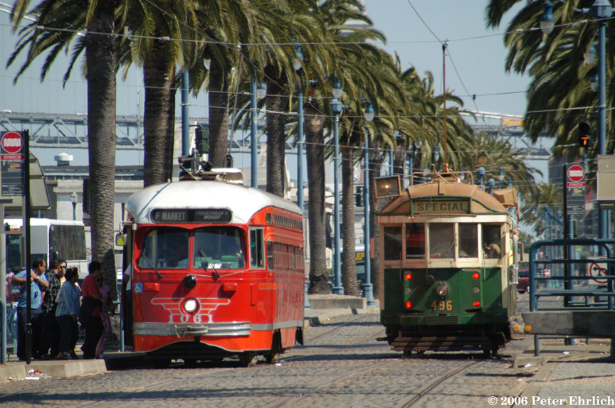 (263k, 864x574)<br><b>Country:</b> United States<br><b>City:</b> San Francisco/Bay Area, CA<br><b>System:</b> SF MUNI<br><b>Location:</b> Embarcadero/Greenwich <br><b>Car:</b> SF MUNI PCC (Ex-SEPTA) (St. Louis Car Co., 1947-1948)  1061 <br><b>Photo by:</b> Peter Ehrlich<br><b>Date:</b> 7/21/2006<br><b>Notes:</b> 1061-Pacific Electric; 496-Melbourne W2.<br><b>Viewed (this week/total):</b> 0 / 549