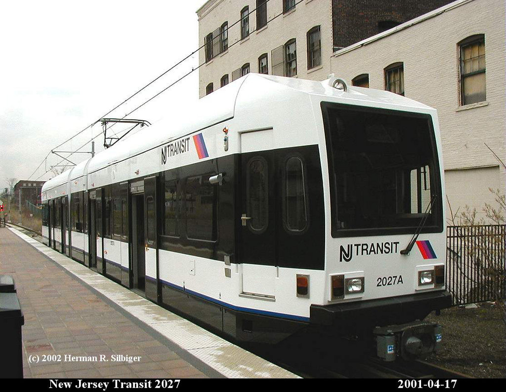 (188k, 1024x795)<br><b>Country:</b> United States<br><b>City:</b> Jersey City, NJ<br><b>System:</b> Hudson Bergen Light Rail<br><b>Location:</b> West Side Avenue <br><b>Car:</b> NJT-HBLR LRV (Kinki-Sharyo, 1998-99)  2027 <br><b>Photo by:</b> Herman R. Silbiger<br><b>Date:</b> 4/17/2001<br><b>Viewed (this week/total):</b> 2 / 1343