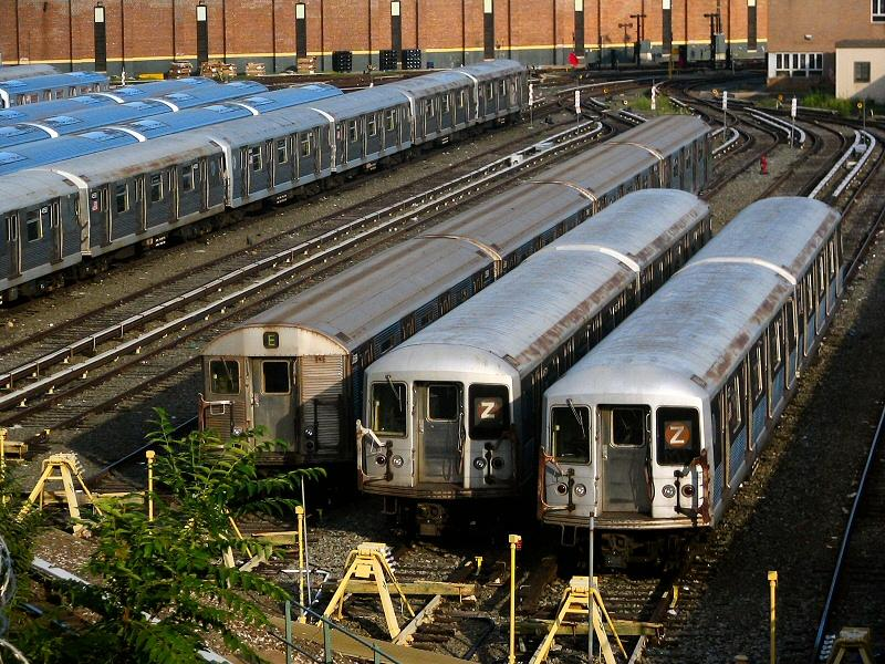 (147k, 800x600)<br><b>Country:</b> United States<br><b>City:</b> New York<br><b>System:</b> New York City Transit<br><b>Location:</b> East New York Yard/Shops<br><b>Car:</b> R-32 (Budd, 1964)  3589 <br><b>Photo by:</b> Dante D. Angerville<br><b>Date:</b> 8/11/2006<br><b>Notes:</b> Train of R32s in East New York yard (which doesn't normally host any R32s). The consist is 3588-3589-3403-3402. With R42s 4571 and 4723.<br><b>Viewed (this week/total):</b> 0 / 3976