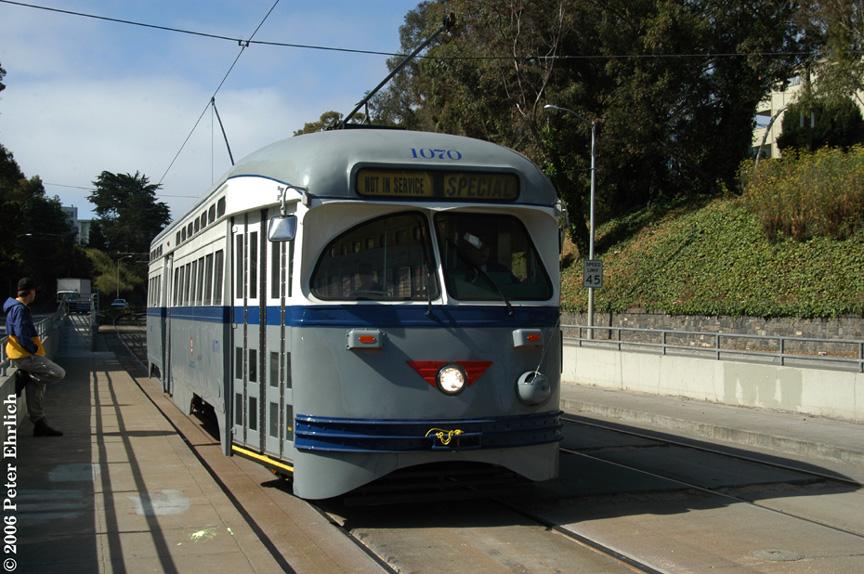 (213k, 864x574)<br><b>Country:</b> United States<br><b>City:</b> San Francisco/Bay Area, CA<br><b>System:</b> SF MUNI<br><b>Line:</b> MUNI Metro (J-Church)<br><b>Location:</b> San Jose/Randall <br><b>Car:</b> SF MUNI PCC (Ex-NJTransit, Ex-Twin City) (St. Louis Car Co., 1946-1947)  1070 <br><b>Photo by:</b> Peter Ehrlich<br><b>Date:</b> 8/10/2006<br><b>Notes:</b> First trial run of ex-Newark PCC 1070. At San Jose/Randall inbound.<br><b>Viewed (this week/total):</b> 1 / 1247