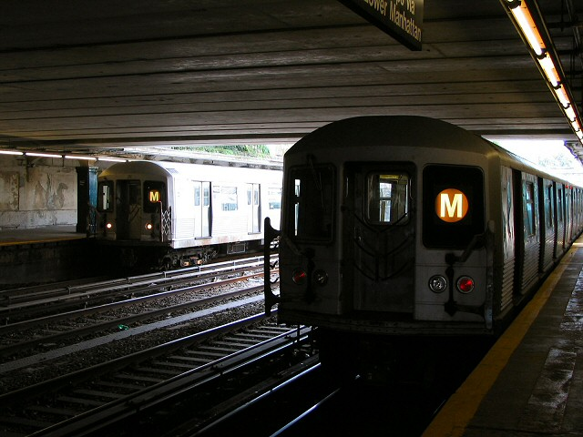 (93k, 640x480)<br><b>Country:</b> United States<br><b>City:</b> New York<br><b>System:</b> New York City Transit<br><b>Line:</b> BMT Sea Beach Line<br><b>Location:</b> Kings Highway <br><b>Route:</b> M<br><b>Car:</b> R-42 (St. Louis, 1969-1970)  4825 <br><b>Photo by:</b> Dante D. Angerville<br><b>Date:</b> 8/22/2006<br><b>Notes:</b> 4825 on left, another R42 on right.<br><b>Viewed (this week/total):</b> 2 / 2555