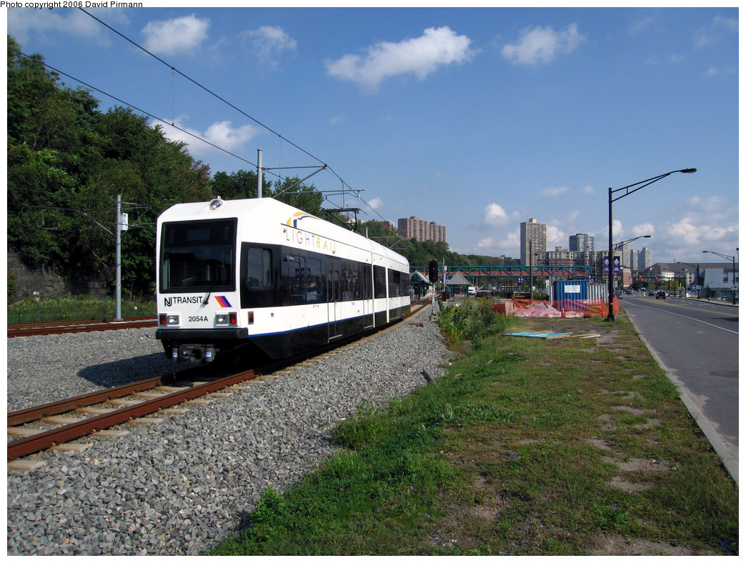 (288k, 1044x788)<br><b>Country:</b> United States<br><b>City:</b> Weehawken, NJ<br><b>System:</b> Hudson Bergen Light Rail<br><b>Location:</b> Port Imperial <br><b>Car:</b> NJT-HBLR LRV (Kinki-Sharyo, 1998-99)  2054 <br><b>Photo by:</b> David Pirmann<br><b>Date:</b> 9/28/2006<br><b>Viewed (this week/total):</b> 0 / 1528