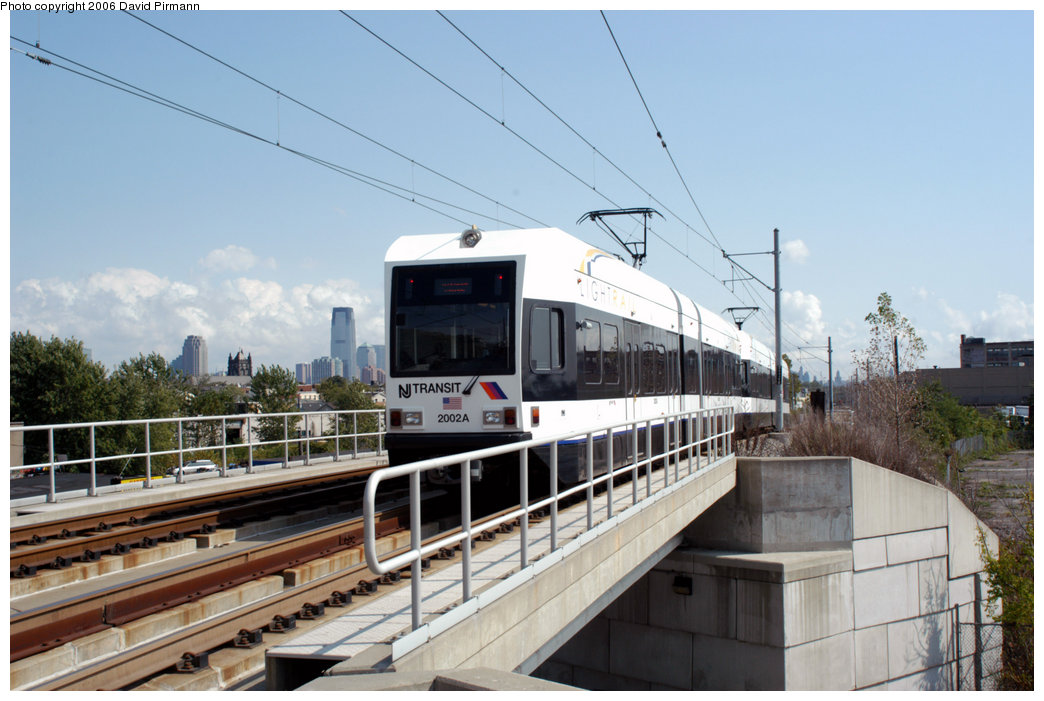 (197k, 1044x701)<br><b>Country:</b> United States<br><b>City:</b> Jersey City, NJ<br><b>System:</b> Hudson Bergen Light Rail<br><b>Location:</b> Garfield Avenue <br><b>Car:</b> NJT-HBLR LRV (Kinki-Sharyo, 1998-99)  2002 <br><b>Photo by:</b> David Pirmann<br><b>Date:</b> 9/28/2006<br><b>Viewed (this week/total):</b> 0 / 1430