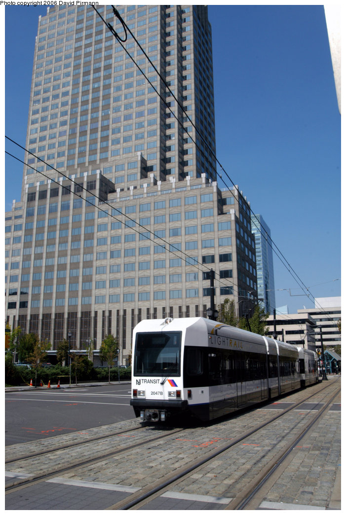 (233k, 701x1044)<br><b>Country:</b> United States<br><b>City:</b> Jersey City, NJ<br><b>System:</b> Hudson Bergen Light Rail<br><b>Location:</b> Exchange Place <br><b>Car:</b> NJT-HBLR LRV (Kinki-Sharyo, 1998-99)  2047 <br><b>Photo by:</b> David Pirmann<br><b>Date:</b> 9/28/2006<br><b>Viewed (this week/total):</b> 1 / 1134