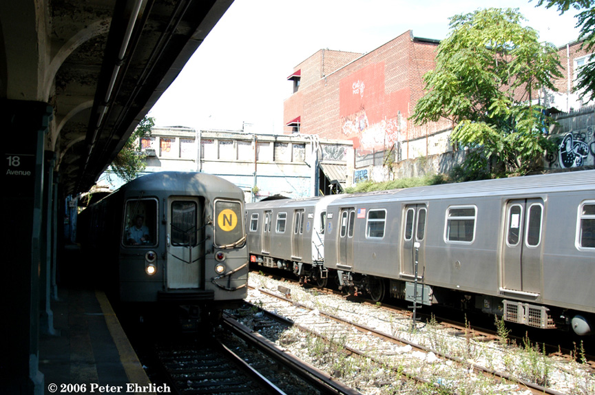 (246k, 864x574)<br><b>Country:</b> United States<br><b>City:</b> New York<br><b>System:</b> New York City Transit<br><b>Line:</b> BMT Sea Beach Line<br><b>Location:</b> 18th Avenue <br><b>Route:</b> N<br><b>Car:</b> R-68A (Kawasaki, 1988-1989)  5084 <br><b>Photo by:</b> Peter Ehrlich<br><b>Date:</b> 9/30/2006<br><b>Notes:</b> With R160 test train on the right.<br><b>Viewed (this week/total):</b> 8 / 1999