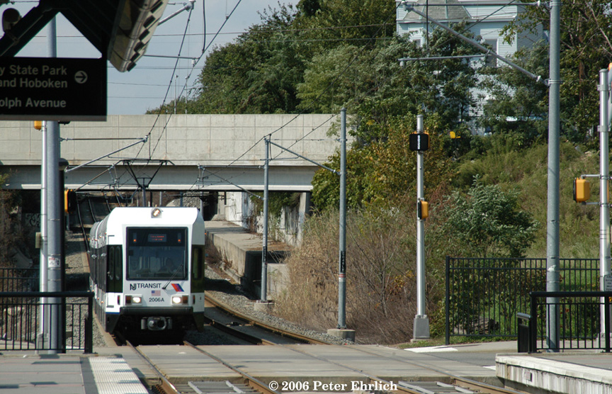 (270k, 864x556)<br><b>Country:</b> United States<br><b>City:</b> Jersey City, NJ<br><b>System:</b> Hudson Bergen Light Rail<br><b>Location:</b> Garfield Avenue <br><b>Car:</b> NJT-HBLR LRV (Kinki-Sharyo, 1998-99)  2006+2002 <br><b>Photo by:</b> Peter Ehrlich<br><b>Date:</b> 9/28/2006<br><b>Viewed (this week/total):</b> 0 / 1310