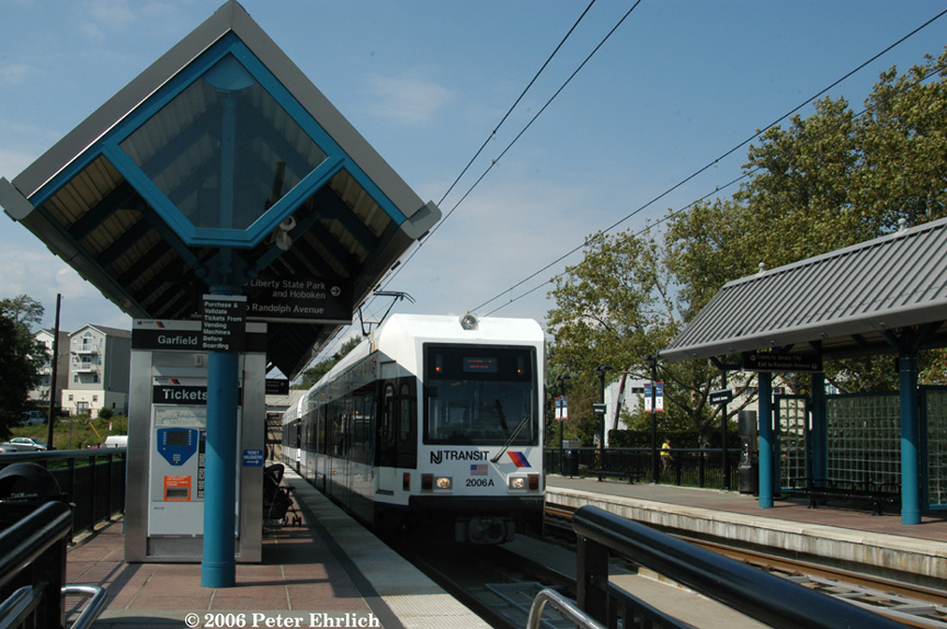 (214k, 864x574)<br><b>Country:</b> United States<br><b>City:</b> Jersey City, NJ<br><b>System:</b> Hudson Bergen Light Rail<br><b>Location:</b> Garfield Avenue <br><b>Car:</b> NJT-HBLR LRV (Kinki-Sharyo, 1998-99)  2006+2002 <br><b>Photo by:</b> Peter Ehrlich<br><b>Date:</b> 9/28/2006<br><b>Viewed (this week/total):</b> 5 / 1394