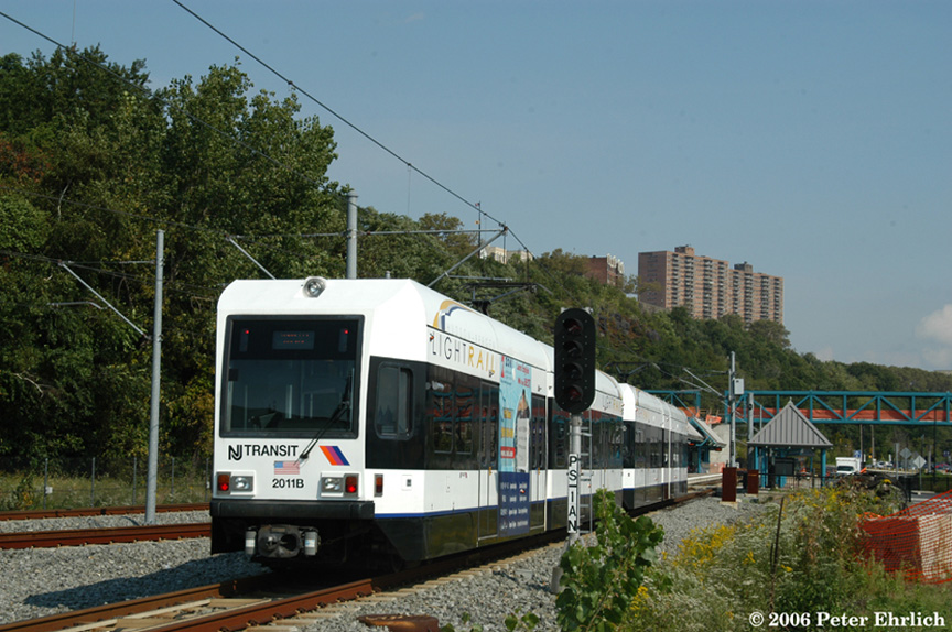 (214k, 864x574)<br><b>Country:</b> United States<br><b>City:</b> Weehawken, NJ<br><b>System:</b> Hudson Bergen Light Rail<br><b>Location:</b> Port Imperial <br><b>Car:</b> NJT-HBLR LRV (Kinki-Sharyo, 1998-99)  2011+2039 <br><b>Photo by:</b> Peter Ehrlich<br><b>Date:</b> 9/28/2006<br><b>Viewed (this week/total):</b> 0 / 1030