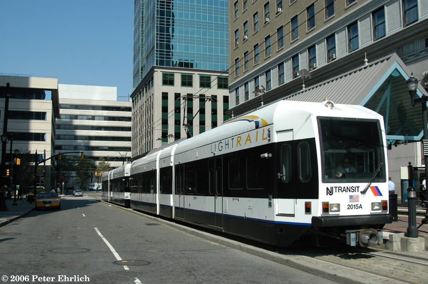 (214k, 864x574)<br><b>Country:</b> United States<br><b>City:</b> Jersey City, NJ<br><b>System:</b> Hudson Bergen Light Rail<br><b>Location:</b> Exchange Place <br><b>Car:</b> NJT-HBLR LRV (Kinki-Sharyo, 1998-99)  2015+2020 <br><b>Photo by:</b> Peter Ehrlich<br><b>Date:</b> 9/28/2006<br><b>Viewed (this week/total):</b> 0 / 1063