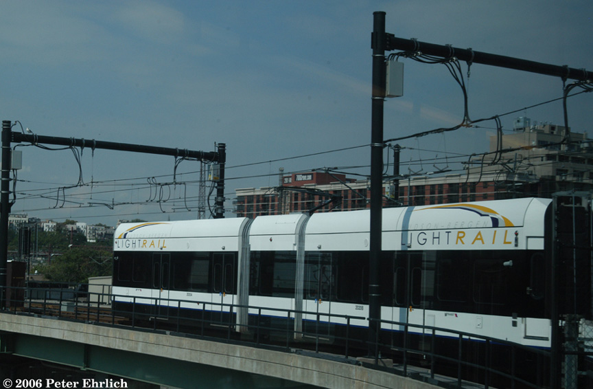 (147k, 864x566)<br><b>Country:</b> United States<br><b>City:</b> Jersey City, NJ<br><b>System:</b> Hudson Bergen Light Rail<br><b>Location:</b> Between Newport & Hoboken <br><b>Car:</b> NJT-HBLR LRV (Kinki-Sharyo, 1998-99)  2020 <br><b>Photo by:</b> Peter Ehrlich<br><b>Date:</b> 9/28/2006<br><b>Notes:</b> Second car of a 2-car train turning from Port Imperial line to main line.<br><b>Viewed (this week/total):</b> 1 / 1310