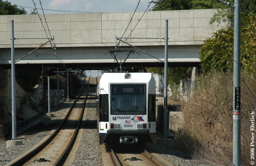 (236k, 864x563)<br><b>Country:</b> United States<br><b>City:</b> Jersey City, NJ<br><b>System:</b> Hudson Bergen Light Rail<br><b>Location:</b> Garfield Avenue <br><b>Car:</b> NJT-HBLR LRV (Kinki-Sharyo, 1998-99)  2020 <br><b>Photo by:</b> Peter Ehrlich<br><b>Date:</b> 9/28/2006<br><b>Viewed (this week/total):</b> 0 / 1275