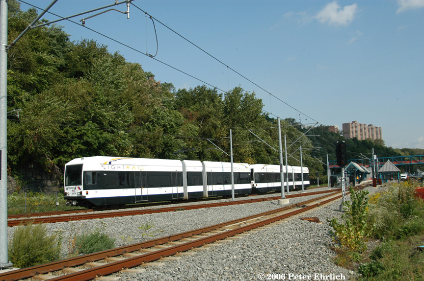 (260k, 864x574)<br><b>Country:</b> United States<br><b>City:</b> Weehawken, NJ<br><b>System:</b> Hudson Bergen Light Rail<br><b>Location:</b> Port Imperial <br><b>Car:</b> NJT-HBLR LRV (Kinki-Sharyo, 1998-99)  2023+2029 <br><b>Photo by:</b> Peter Ehrlich<br><b>Date:</b> 9/28/2006<br><b>Viewed (this week/total):</b> 1 / 1131