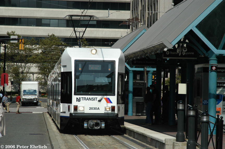 (203k, 864x574)<br><b>Country:</b> United States<br><b>City:</b> Jersey City, NJ<br><b>System:</b> Hudson Bergen Light Rail<br><b>Location:</b> Exchange Place <br><b>Car:</b> NJT-HBLR LRV (Kinki-Sharyo, 1998-99)  2030 <br><b>Photo by:</b> Peter Ehrlich<br><b>Date:</b> 9/28/2006<br><b>Viewed (this week/total):</b> 0 / 1201