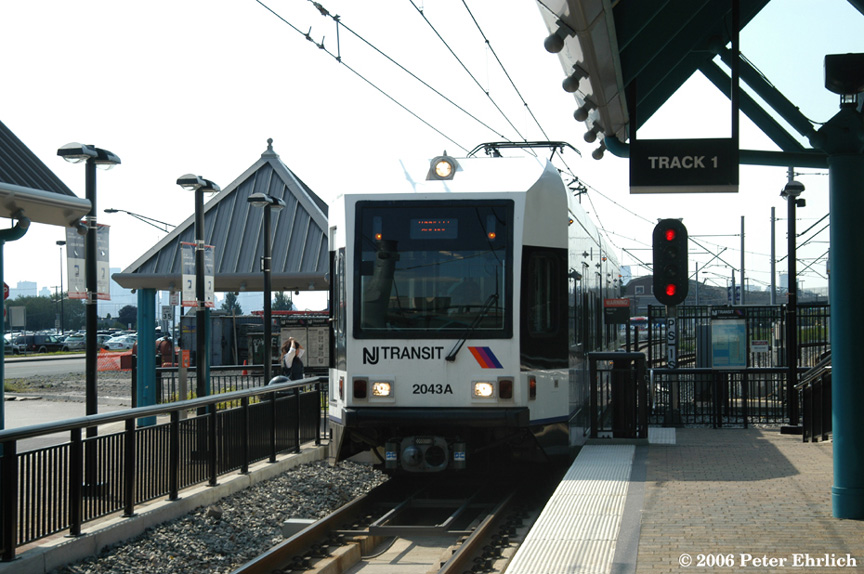 (195k, 864x574)<br><b>Country:</b> United States<br><b>City:</b> Weehawken, NJ<br><b>System:</b> Hudson Bergen Light Rail<br><b>Location:</b> Port Imperial <br><b>Car:</b> NJT-HBLR LRV (Kinki-Sharyo, 1998-99)  2043 <br><b>Photo by:</b> Peter Ehrlich<br><b>Date:</b> 9/28/2006<br><b>Viewed (this week/total):</b> 2 / 1319
