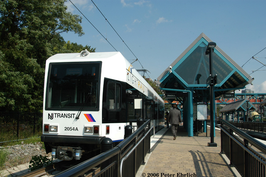 (222k, 864x574)<br><b>Country:</b> United States<br><b>City:</b> Weehawken, NJ<br><b>System:</b> Hudson Bergen Light Rail<br><b>Location:</b> Port Imperial <br><b>Car:</b> NJT-HBLR LRV (Kinki-Sharyo, 1998-99)  2054 <br><b>Photo by:</b> Peter Ehrlich<br><b>Date:</b> 9/28/2006<br><b>Viewed (this week/total):</b> 0 / 1260