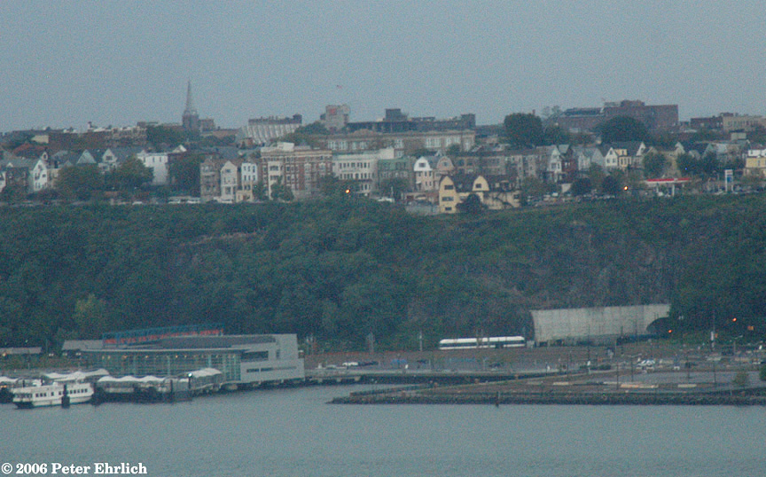 (224k, 864x538)<br><b>Country:</b> United States<br><b>City:</b> Weehawken, NJ<br><b>System:</b> Hudson Bergen Light Rail<br><b>Location:</b> Weehawken (Palisade) Tunnel (East Portal) <br><b>Photo by:</b> Peter Ehrlich<br><b>Date:</b> 10/1/2006<br><b>Notes:</b> A view of a train approaching the Weehawken Tunnel, taken from 70th & Riverside in Manhattan.<br><b>Viewed (this week/total):</b> 0 / 1906