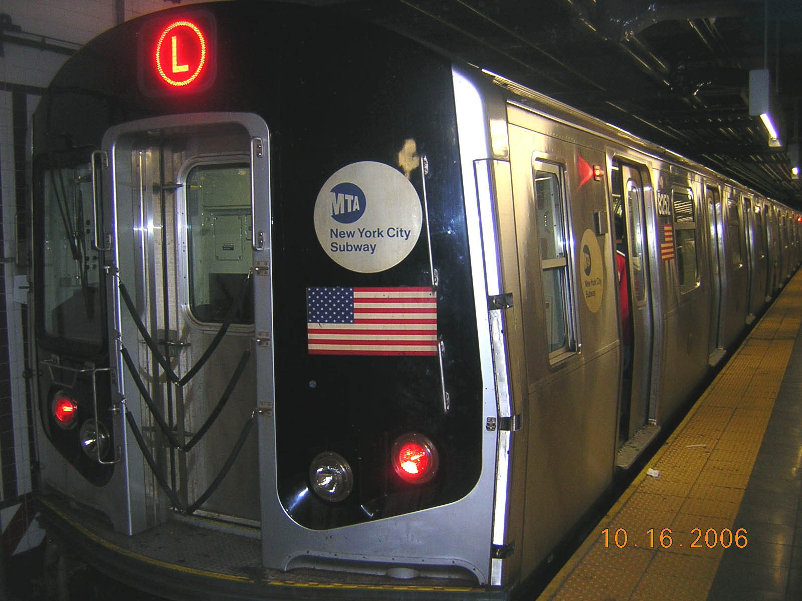 (223k, 1600x1200)<br><b>Country:</b> United States<br><b>City:</b> New York<br><b>System:</b> New York City Transit<br><b>Line:</b> BMT Canarsie Line<br><b>Location:</b> 8th Avenue <br><b>Route:</b> L<br><b>Car:</b> R-143 (Kawasaki, 2001-2002) 8252 <br><b>Photo by:</b> Robert Mencher<br><b>Date:</b> 10/16/2006<br><b>Viewed (this week/total):</b> 2 / 1572