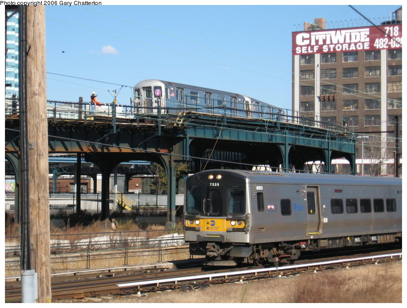 (140k, 820x620)<br><b>Country:</b> United States<br><b>City:</b> New York<br><b>System:</b> New York City Transit<br><b>Location:</b> Viaduct approach east of Hunterspoint Ave. <br><b>Route:</b> 7<br><b>Car:</b> R-62A (Bombardier, 1984-1987)  1710 <br><b>Photo by:</b> Gary Chatterton<br><b>Date:</b> 11/4/2006<br><b>Notes:</b> With LIRR M7 7225.<br><b>Viewed (this week/total):</b> 0 / 3459