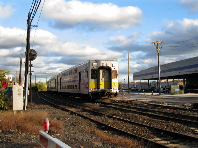 (117k, 820x615)<br><b>Country:</b> United States<br><b>City:</b> New York<br><b>System:</b> Long Island Rail Road<br><b>Line:</b> LIRR Long Island City<br><b>Location:</b> 43rd Street nr 56th Rd. <br><b>Car:</b> LIRR Kawasaki C-3/C-R (Bilevel Coach/Cab) 5017 <br><b>Photo by:</b> Gary Chatterton<br><b>Date:</b> 10/20/2006<br><b>Viewed (this week/total):</b> 0 / 923