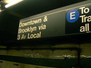 (119k, 320x240)<br><b>Country:</b> United States<br><b>City:</b> New York<br><b>System:</b> New York City Transit<br><b>Line:</b> IND 8th Avenue Line<br><b>Location:</b> West 4th Street/Washington Square <br><b>Photo by:</b> Mike Jiran<br><b>Date:</b> 10/8/2006<br><b>Notes:</b> Sign indicating 3 Av local on the 8th Ave. platform at West 4th. Close inspection shows the 3 wasn't an 8 changed as a prank, the 3 is as old as the sign itself. The other half of the sign has been pasted over enough times to suggest that at the very least it predates 9/11/01, because you can see where it temporarily said To Canal Street, all times while the WTC portion of Chambers was shut down.<br><b>Viewed (this week/total):</b> 1 / 2306