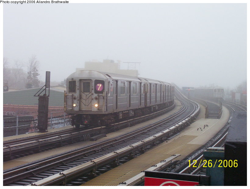 (100k, 820x620)<br><b>Country:</b> United States<br><b>City:</b> New York<br><b>System:</b> New York City Transit<br><b>Line:</b> IRT Flushing Line<br><b>Location:</b> 103rd Street/Corona Plaza <br><b>Route:</b> 7<br><b>Car:</b> R-62A (Bombardier, 1984-1987)  1656 <br><b>Photo by:</b> Aliandro Brathwaite<br><b>Date:</b> 12/26/2006<br><b>Viewed (this week/total):</b> 5 / 2061