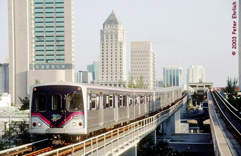 (159k, 792x515)<br><b>Country:</b> United States<br><b>City:</b> Miami, FL<br><b>System:</b> Miami Metrorail<br><b>Location:</b> Overtown/Arena <br><b>Car:</b>  221 <br><b>Photo by:</b> Peter Ehrlich<br><b>Date:</b> 4/25/2003<br><b>Notes:</b> Approaching Overtown/Arena Station northbound.  Cars in Miami-Dade Transit's new color scheme.<br><b>Viewed (this week/total):</b> 1 / 3351