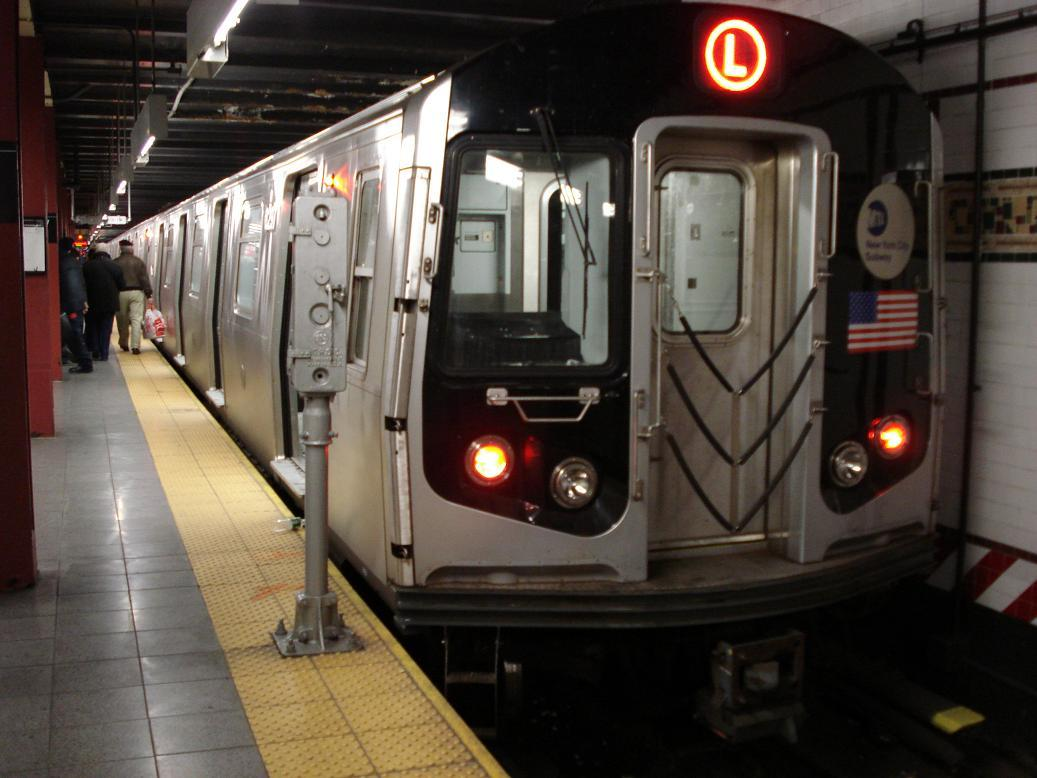 (110k, 1037x778)<br><b>Country:</b> United States<br><b>City:</b> New York<br><b>System:</b> New York City Transit<br><b>Line:</b> BMT Canarsie Line<br><b>Location:</b> 8th Avenue <br><b>Route:</b> L<br><b>Car:</b> R-143 (Kawasaki, 2001-2002) 8297 <br><b>Photo by:</b> Michael Hodurski<br><b>Date:</b> 12/29/2006<br><b>Viewed (this week/total):</b> 0 / 2573