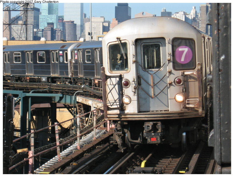 (133k, 820x620)<br><b>Country:</b> United States<br><b>City:</b> New York<br><b>System:</b> New York City Transit<br><b>Line:</b> IRT Flushing Line<br><b>Location:</b> Queensborough Plaza <br><b>Route:</b> 7<br><b>Car:</b> R-62A (Bombardier, 1984-1987)  1985 <br><b>Photo by:</b> Gary Chatterton<br><b>Date:</b> 12/9/2006<br><b>Viewed (this week/total):</b> 0 / 2185
