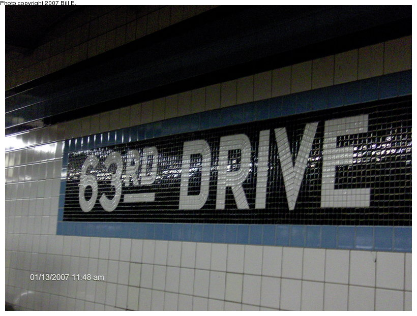 (110k, 820x622)<br><b>Country:</b> United States<br><b>City:</b> New York<br><b>System:</b> New York City Transit<br><b>Line:</b> IND Queens Boulevard Line<br><b>Location:</b> 63rd Drive/Rego Park <br><b>Photo by:</b> Bill E.<br><b>Date:</b> 1/13/2007<br><b>Notes:</b> Wall mosaic sign.<br><b>Viewed (this week/total):</b> 0 / 1128