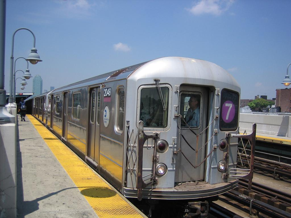 (118k, 1024x768)<br><b>Country:</b> United States<br><b>City:</b> New York<br><b>System:</b> New York City Transit<br><b>Line:</b> IRT Flushing Line<br><b>Location:</b> 33rd Street/Rawson Street <br><b>Route:</b> 7<br><b>Car:</b> R-62A (Bombardier, 1984-1987)  2048 <br><b>Photo by:</b> Michael Hodurski<br><b>Date:</b> 7/2/2006<br><b>Viewed (this week/total):</b> 0 / 1185