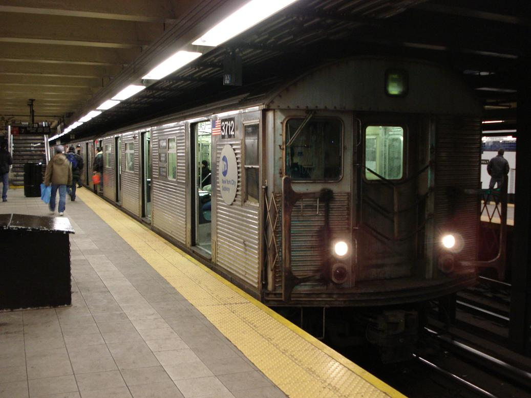 (111k, 1037x778)<br><b>Country:</b> United States<br><b>City:</b> New York<br><b>System:</b> New York City Transit<br><b>Line:</b> IND Queens Boulevard Line<br><b>Location:</b> Roosevelt Avenue <br><b>Route:</b> E<br><b>Car:</b> R-32 (Budd, 1964)  3712 <br><b>Photo by:</b> Michael Hodurski<br><b>Date:</b> 2/18/2007<br><b>Viewed (this week/total):</b> 7 / 1913