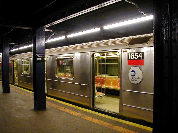 (80k, 600x450)<br><b>Country:</b> United States<br><b>City:</b> New York<br><b>System:</b> New York City Transit<br><b>Line:</b> IRT West Side Line<br><b>Location:</b> Chambers Street <br><b>Route:</b> 1<br><b>Car:</b> R-62A (Bombardier, 1984-1987)  1654 <br><b>Photo by:</b> Trevor Logan<br><b>Date:</b> 6/10/2001<br><b>Viewed (this week/total):</b> 0 / 7654