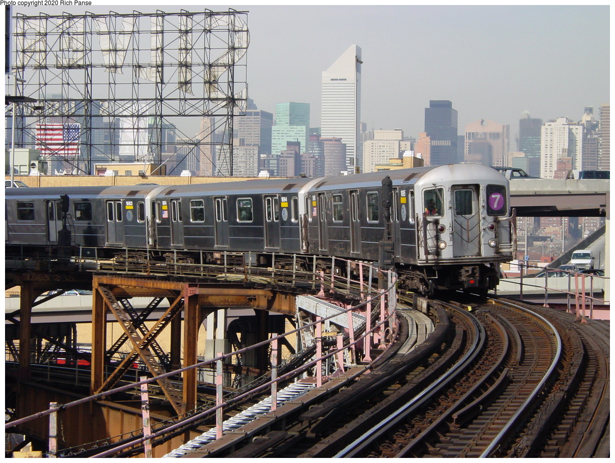 (114k, 820x620)<br><b>Country:</b> United States<br><b>City:</b> New York<br><b>System:</b> New York City Transit<br><b>Line:</b> IRT Flushing Line<br><b>Location:</b> Queensborough Plaza <br><b>Route:</b> 7<br><b>Car:</b> R-62A (Bombardier, 1984-1987)  1685 <br><b>Photo by:</b> Richard Panse<br><b>Date:</b> 3/7/2002<br><b>Viewed (this week/total):</b> 0 / 3849