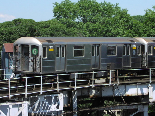 (98k, 600x450)<br><b>Country:</b> United States<br><b>City:</b> New York<br><b>System:</b> New York City Transit<br><b>Line:</b> IRT White Plains Road Line<br><b>Location:</b> West Farms Sq./East Tremont Ave./177th St. <br><b>Route:</b> 5<br><b>Car:</b> R-62A (Bombardier, 1984-1987)  1705 <br><b>Photo by:</b> Trevor Logan<br><b>Date:</b> 9/2001<br><b>Viewed (this week/total):</b> 2 / 5806