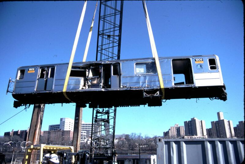 (80k, 800x538)<br><b>Country:</b> United States<br><b>City:</b> New York<br><b>System:</b> New York City Transit<br><b>Location:</b> 207th Street Yard<br><b>Car:</b> R-62A (Bombardier, 1984-1987)  1909 <br><b>Photo by:</b> Glenn L. Rowe<br><b>Date:</b> 3/19/2001<br><b>Notes:</b> Damaged in accident 11/24/1996<br><b>Viewed (this week/total):</b> 6 / 23948