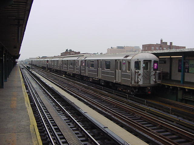 (60k, 640x480)<br><b>Country:</b> United States<br><b>City:</b> New York<br><b>System:</b> New York City Transit<br><b>Line:</b> IRT Flushing Line<br><b>Location:</b> 74th Street/Broadway <br><b>Car:</b> R-62A (Bombardier, 1984-1987)  2114 <br><b>Photo by:</b> Salaam Allah<br><b>Date:</b> 9/26/2002<br><b>Viewed (this week/total):</b> 2 / 2534